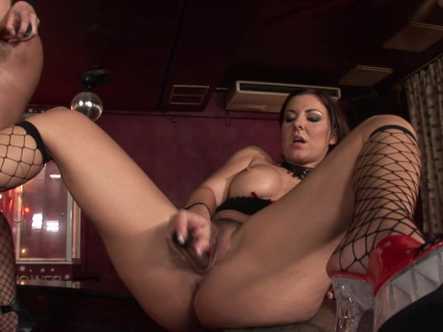 Big breasted brunette chick in fishnets fucking a massive dildo