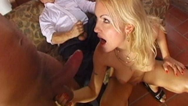 Hot blonde amateur babe giving blowjob in a threesome